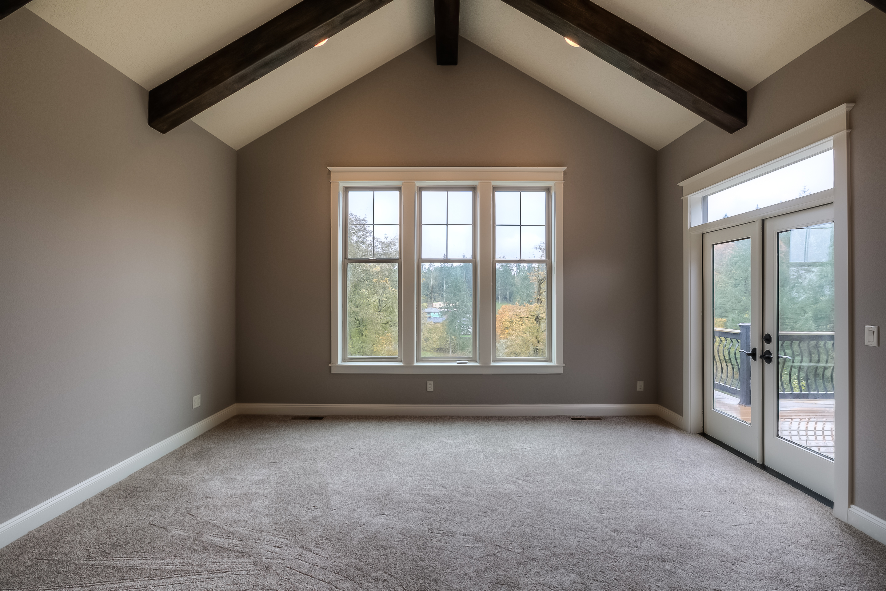 in keeping with the lodge theme throughout exposed beams were also installed in the master suite wall color perfect greige by sherwin williams carpet